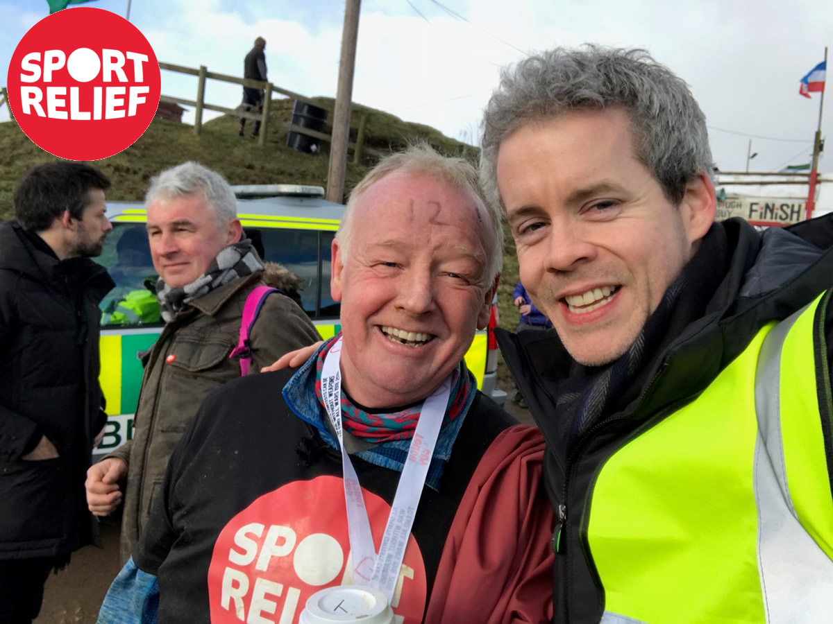 Les Dennis with fitness trainer Robert Brennan after completing Tough Guy for Sport Relief